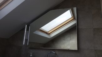Shaped mirror with steam demister and side light for attic bathroom in Leopardstown Co Dublin