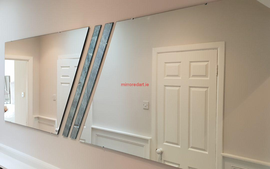 Mount Merrion Blackrock Co Dublin. A split angled mirror with two antique  mirrors in the middle covering a large area with a twist.