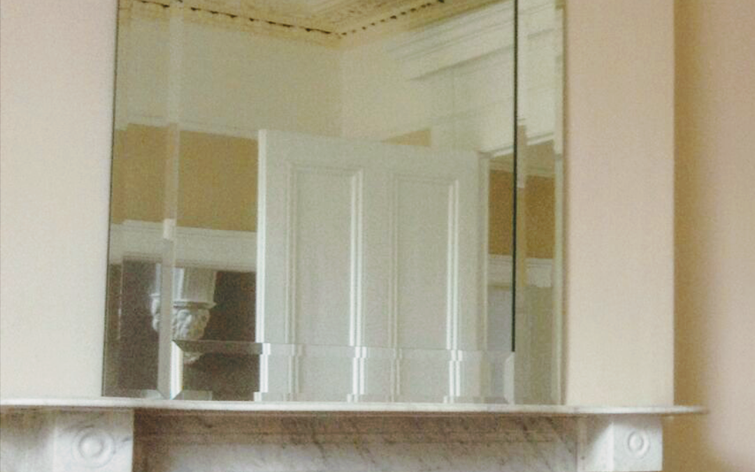 A large bevelled  framed mirror  one of a matching  pair made  for a front and rear room residence in kennilworth square Rathmines Dublin 6