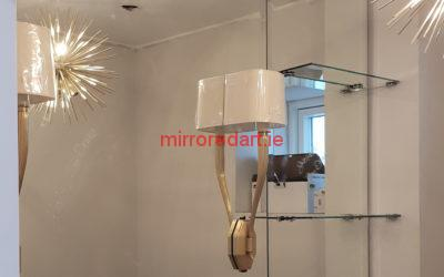 Bathroom  mirror with vertical lights and glass shelves.  Taylor's Hill Galway.
