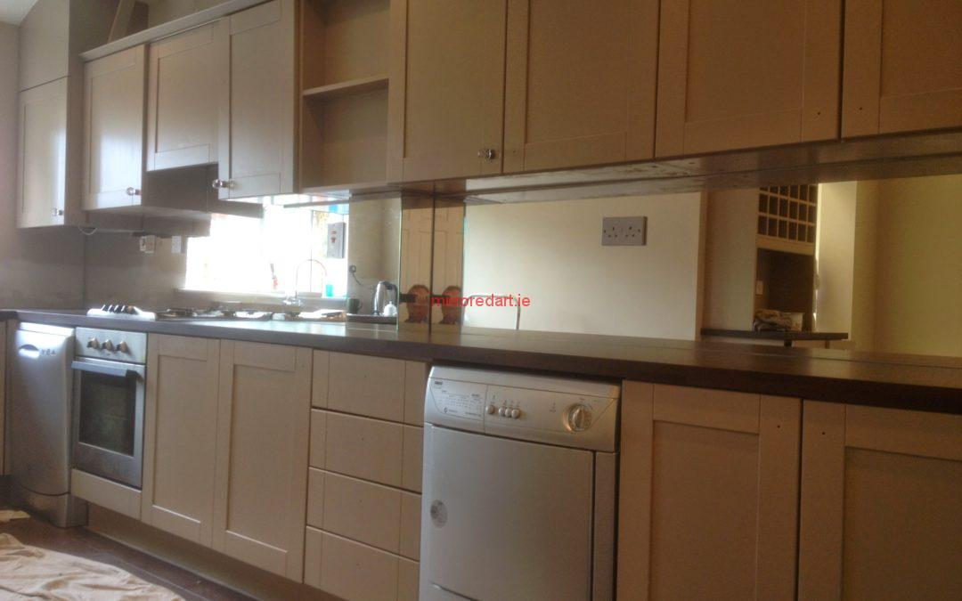 Silver mirrored splash back with cut outs for the electrical sockets for a house in Lusk North co Dublin.