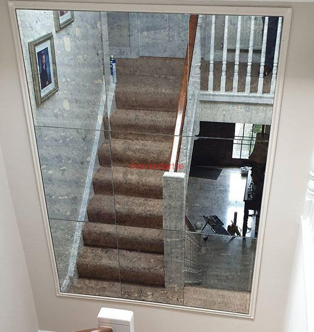 One of  our Anitque mirrors in a frame on the turn of a stairs reflecting more light to the hall downstairs.
